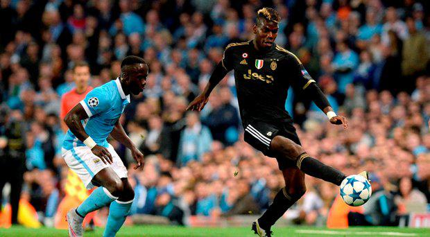 Juventus' Paul Pogba (right) and Manchester City's Bacary Sagna during the UEFA Champions League match at the Etihad Stadium, Manchester