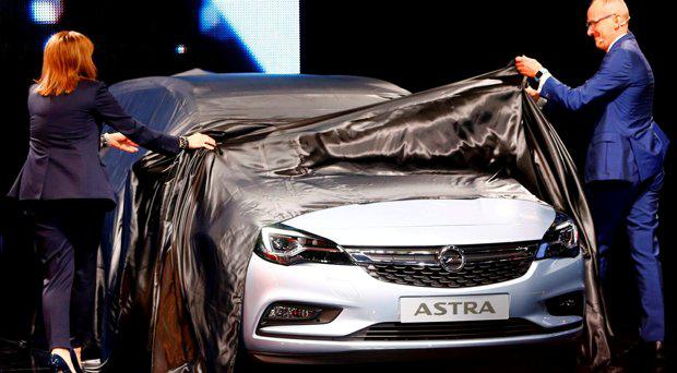 General Motors CEO Mary Barra and Opel CEO Karl-Thomas Neumann (R) present the new Opel Astra during the media day at the Frankfurt Motor Show (IAA) in Frankfurt, Germany September 15, 2015