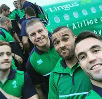 Members of the Irish Rugby team take a selfie before baording an Aer Lingus plane and departing for Cardiff.