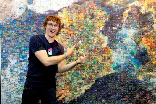 Web Summit Founder Paddy Cosgrave, Web Summit Founder placing the last tile to complete the mosaic map of Ireland made up of attendee's photos. Photo: Julien Behal.