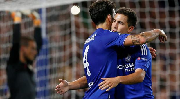 Cesc Fabregas celebrates with Eden Hazard after scoring the fourth goal for Chelsea