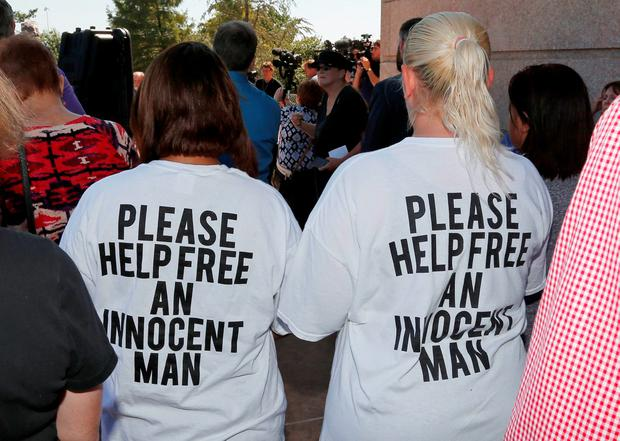 Ericka Glossip-Hodge, left, daughter of Richard Glossip, and Billie Jo Ogden Boyiddle, right, Richard Glossip's sister, listen during a rally to stop the execution of Richard Glossip (AP Photo/Sue Ogrocki)