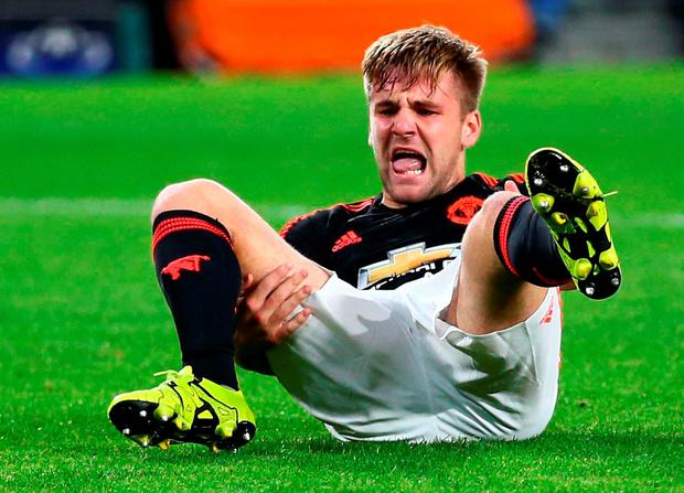 Manchester United's Luke Shaw feels the pain after breaking his leg in Eindhoven on Tuesday night