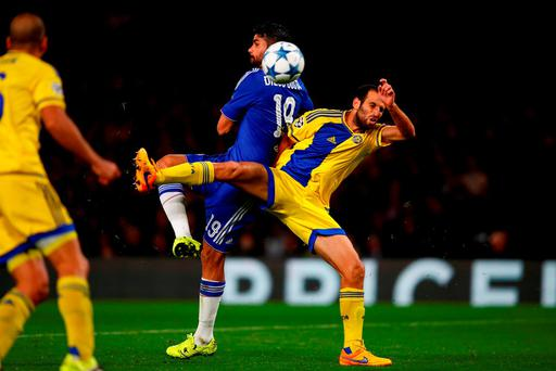 Chelsea's Diego Costa finds the net despite being under pressure from Yuval Shpungin of Maccabi Tel Aviv