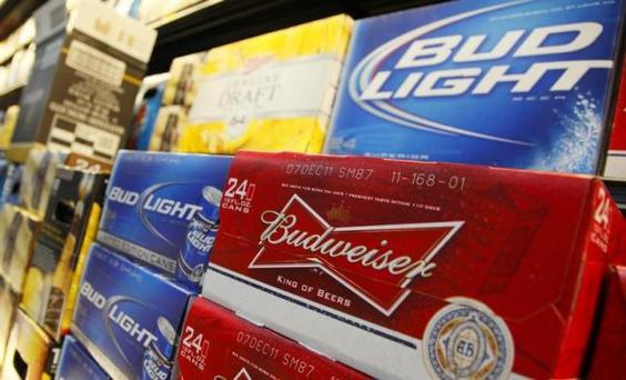 Anheuser Busch's Budweiser and Bud Light Beer can be seen on display at a new Wal-Mart store in Chicago, January 24, 2012. REUTERS/John Gress