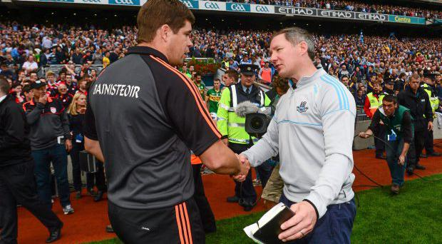Dublin manager Jim Gavin, right, shakes hands with Kerry manager Eamonn Fitzmaurice after the final in 2013