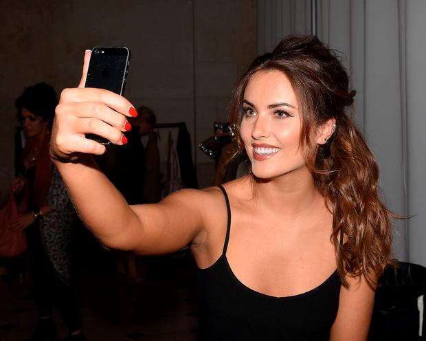 Holly Carpenter take a selfie at the 100 Colours Fashion Show at City Hall, Dublin