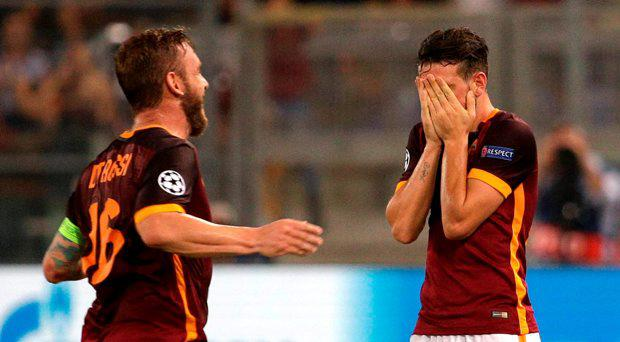 AS Roma's Alessandro Florenzi (R) celebrates with his team mate Daniele De Rossi after scoring against Barcelona's during their Champions League Group E stage match at the Olympic stadium in Rome, Italy , September 16, 2015. REUTERS/Max Rossi