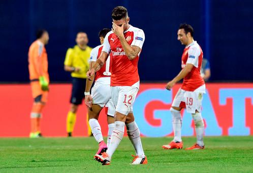 Arsenal's French forward Olivier Giroud (L) leaves the pitch after receiving the second yellow car during the UEFA Champions League Group F football match between GNK Dinamo Zagreb and Arsenal
