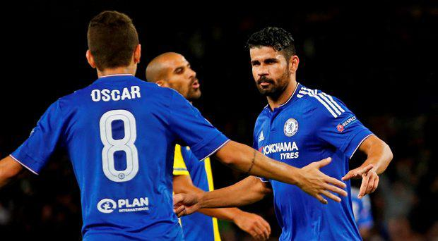 Diego Costa celebrates with Oscar after scoring the third goal for Chelsea