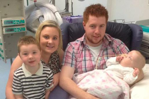 Baby Jessica Hall with her mum Elaine and dad Stephen and brother Daniel