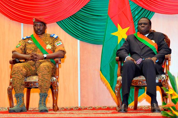 Interim President of Burkina Faso Michel Kafando (R) and Prime Minister Lt. Col. Isaac Zida (L), who have been detained by those behind the coup Credit: SIA KAMBOU (Getty Images)