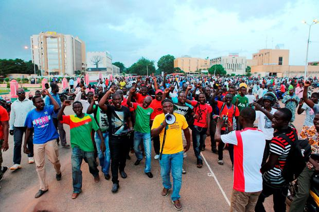 Protesters chant slogans outside Burkina Faso's presidential palace credit: REUTERS/Joe Penney