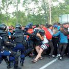 Hungarian riot police charge migrants at the border crossing with Serbia in Roszke, Hungary