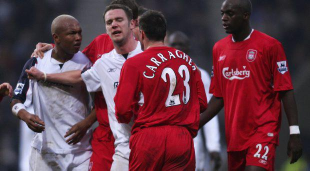 El Hadji Diouf (L) of Bolton is kept apart from Jamie Carragher of Liverpool