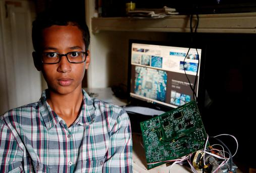 Irving MacArthur High School student Ahmed Mohamed (14) poses with homemade clock Credit: Vernon Bryant/The Dallas Morning News (AP)