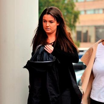 Gaby Scanlon (centre) who had to have her stomach removed after drinking a cocktail mixed with liquid nitrogen bought on her 18th birthday from Oscar's bar in Lancaster, arrives at Preston Crown Court Peter Byrne/PA Wire