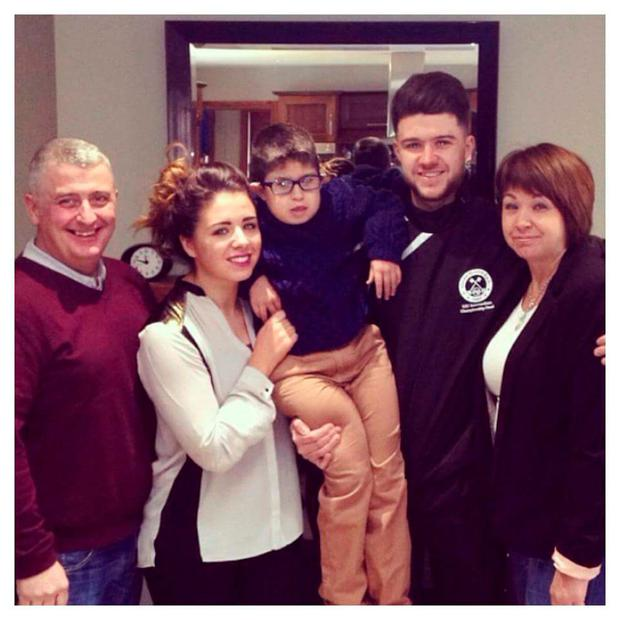 Conleth pictured with his family and Tomas