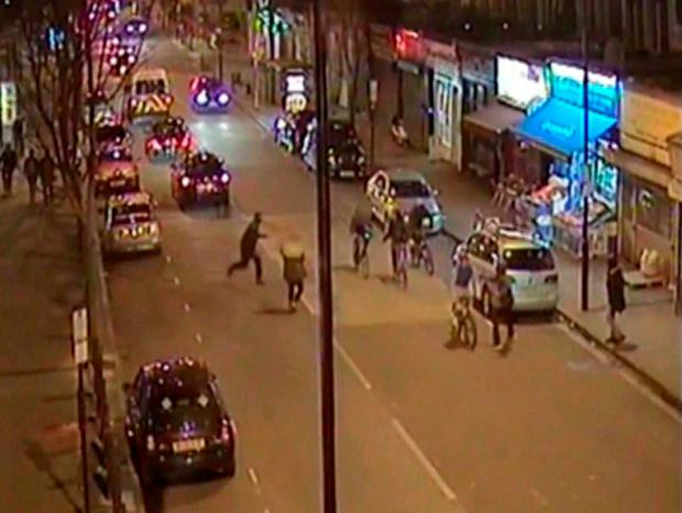 The moment Alan Cartwright, in front wearing a blue top riding his bike, was stabbed in the chest as he was cycling with friends along a busy road in north London Credit: Metropolitan Police/PA Wire