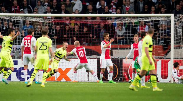 Celtic Glasgow's players react after scoring the during the Europa League at the Amsterdam Arena