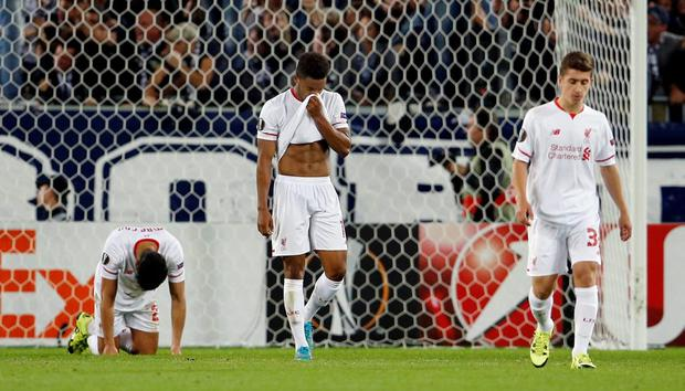 Liverpool's Joe Gomez and team mates look dejected after Jussie equalised for Bordeaux