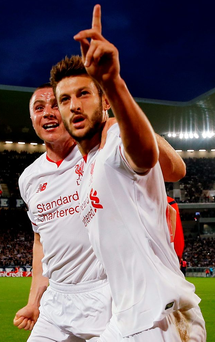 Adam Lallana celebrates his goal with Jordan Rossiter