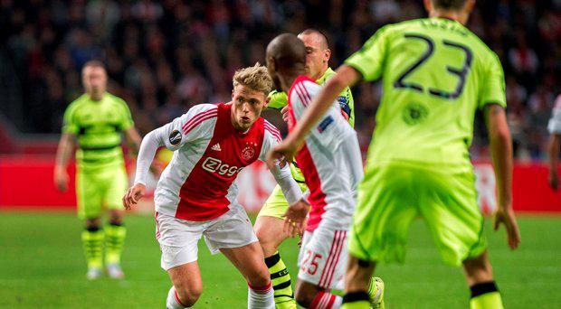 Ajax's Viktor Fischer controls the ball during the Europe League Group A soccer match between Ajax Amsterdam and Celtic Glasgow at the ArenA stadium in Amsterdam