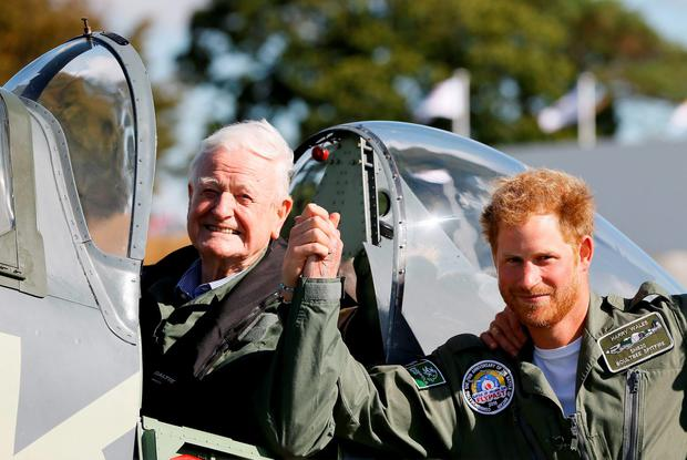 Britain's Prince Harry (R) poses with World War II veteran Tom Neill after he flew in a Spitfire during a Battle of Britain display at Goodwood Aerodrome in West Sussex