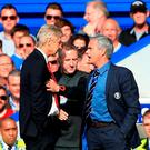 Chelsea manager Jose Mourinho (right) has a heated exchange with Arsenal manager Arsene Wenger (left) on the touchline during the Barclays Premier League match at Stamford Bridge last season