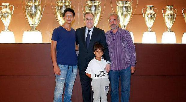Osama Alabed Al Mohsen received by club president Florentino Perez