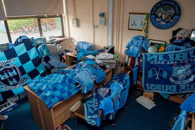 Friday 18 September 2015. Holy Trinity SNS, Grange Rd. Donaghmede Headmaster Jerry Grogan from Kerry has had his office converted to a Dubs shrine by some of his students and a Kerry teacher is also suspected of being complicit.
