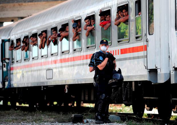 Croatian Police stand beside a train carrying a 1,000 migrants bound for Hungary Credit: STRSTR/AFP/Getty Images