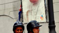 A couple on a scooter ride past a poster in a street in Havana welcoming Pope Francis, who visits Cuba today