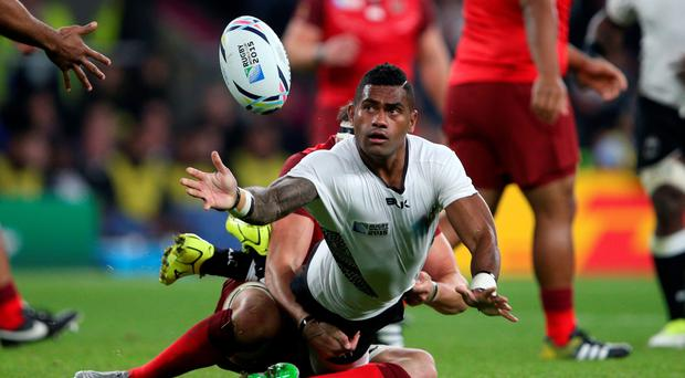 Fiji's Nikola Matawalu passes away during the Rugby World Cup match at Twickenham. David Davies/PA Wire.