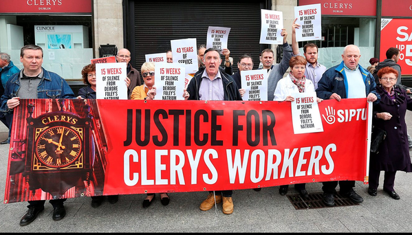Former Clerys staff and supporters at the 'Justice for Clerys Workers' protest outside the shop on O'Connell Street Photo: Steve Humphreys