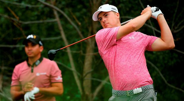 Jordan Spieth drives off at the BMW Championship at Lake Forest as his world rankings rival Jason Day looks on