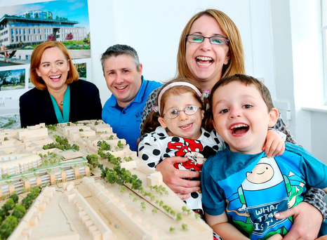 Pictured is Saoirse Dunne, her mother Elisha and brother James with Eilísh Hardiman, chief executive of the Children's Hospital Group, at the launch of a new information centre