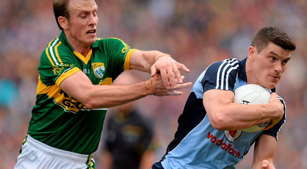 Kerry's Donnchadh Walsh and Diarmuid Connolly of Dublin - seen here in action in the 2013 All-Ireland semi-final - will have key roles to play in tomorrow's Croke Park showdown