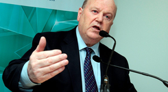 Finance Minister Michael Noonan has urged the Central Bank to review mortgage caps for first-time buyers