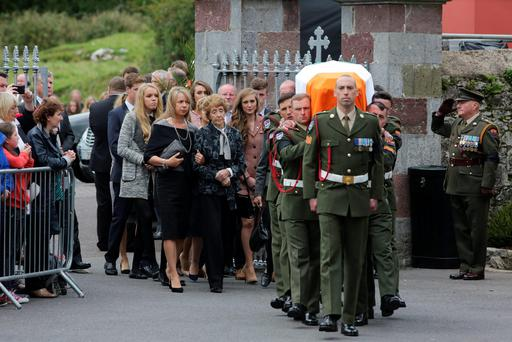 The remains of Thomas Kent are shouldered to St Nicholas Church Castlelyons, Co Cork, as family members follow his coffin Photo: Mark Condrenthe