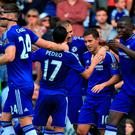 Chelsea's Eden Hazard (second right) celebrates with his teammates after scoring his side's second goal of the game during the Barclays Premier League match at Stamford Bridge, London. PRESS ASSOCIATION Photo. Picture date: Saturday September 19, 2015. See PA story SOCCER Chelsea. Photo credit should read: John Walton/PA Wire. RESTRICTIONS: EDITORIAL USE ONLY No use with unauthorised audio, video, data, fixture lists, club/league logos or