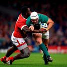 Ireland's Rory Best gets tackled by Canada's Djustice Sears-Duru (left) during the Rugby World Cup match at The Millennium Stadium, Cardiff. PRESS ASSOCIATION Photo. Picture date: Saturday September 19, 2015. See PA story RUGBYU Ireland. Photo credit should read: Mike Egerton/PA Wire. RESTRICTIONS: Editorial use only. Strictly no commercial use or association without RWCL permission. Still image use only. Use implies acceptance of Section 6 of RWC 2015 T&Cs at: http://bit.ly/1MPElTL Call +44 (0)1158 447447 for further info.