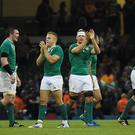 Irish players celebrate after winning a Pool D match of the 2015 Rugby World Cup between Ireland and Canada at the Millenium stadium in Cardiff, south Wales on September 19, 2015.