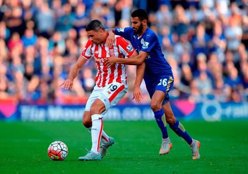 Jonathan Walters of Stoke City and Riyad Mahrez of Leicester City compete for the ball (Photo by Gareth Copley/Getty Images)
