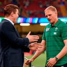 Former Ireland centre Brian O'Driscoll in conversation with Ireland head coach Joe Schmidt ahead of the game with Canada last week. Picture credit: Stephen McCarthy / SPORTSFILE
