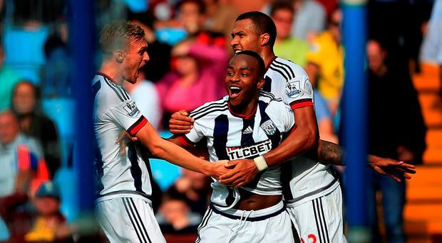 West Bromwich Albion's Saido Berahino (centre) celebrates scoring the opening goal against Aston Villa with Darren Fletcher (left) and Solomon Rondon during the Barclays Premier League match at Villa Park