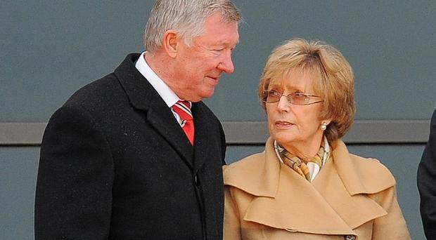 Alex Ferguson said he needed to put his wife 'first' (Getty/AFP)
