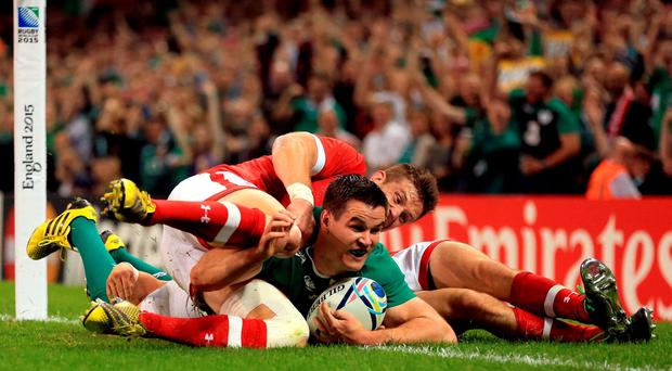 Ireland's Johnny Sexton scores his side's third try of the game during the Rugby World Cup match at The Millennium Stadium, Cardiff.