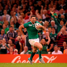 Rob Kearney shows his delight as he races clear to score his side's sixth try against Canada yesterday