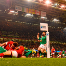 Jonathan Sexton, Ireland, goes over to score his side's third try, despite the efforts of Matt Evans and Gordon McRorie